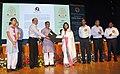 The Minister of State for Human Resource Development, Shri Upendra Kushwaha felicitating a teacher, on the occasion of the CBSE Teachers' award 2015, in New Delhi.jpg