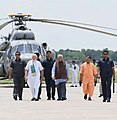 The Prime Minister, Shri Narendra Modi being seen off by the Governor of Uttar Pradesh, Shri Ram Naik and the Chief Minister of Uttar Pradesh, Yogi Adityanath, on his departure from Varanasi, Uttar Pradesh on July 15, 2018.JPG