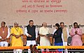 The Prime Minister, Shri Narendra Modi distributing the laptopscertificatescheques etc. to the beneficiaries under various schemes, at a function, in Bhilai, Chhattisgarh.JPG