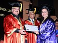 The Union Minister for Health & Family Welfare, Shri J.P. Nadda presenting the Phd degree to a student at the 20th Convocation Ceremony of NIMHANS, at Bengaluru on February 13, 2016.jpg