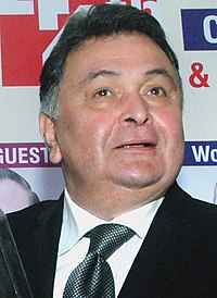 "Rishi Kapoor The Union Minister for Human Resource Development, Shri Prakash Javadekar presenting the Giants Award to Shri Rishi Kapoor for films field, at the ""44th Giants Day Celebration"", in Mumbai on September 17, 2016 (cropped).jpg"