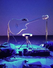 A guitar on a pedestal