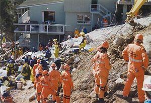 1997 Thredbo landslide - SES volunteers (orange) and firemen (yellow) assist at the Thredbo debris slope 1997