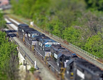 Miniature faking - A digitally blurred image of a Norfolk Southern freight train