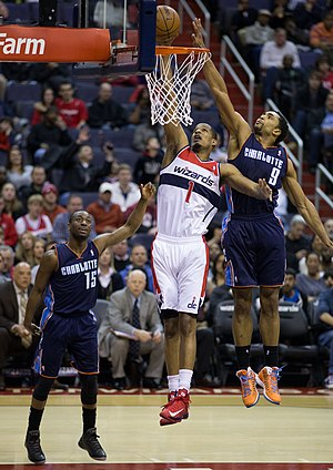 Gerald Henderson Jr. - Henderson (No. 9) attempting to block Trevor Ariza's layup