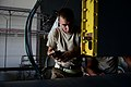 U.S. Air Force Senior Airman Jessie Mechling, an electronic warfare systems journeyman with the 41st Expeditionary Electronic Combat Squadron, performs electrical maintenance on an EC-130H Compass Call aircraft 140825-F-PB969-045.jpg