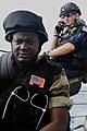 U.S. Coast Guard Maritime Enforcement Specialist, right, with the Maritime Security Response Team, talks to the bridge of the guided missile frigate USS Simpson (FFG 56) as Senegalese Navy 120623-N-GN377-133.jpg