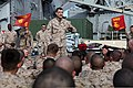 U.S. Marine Corps Col. Frank Donovan, center, commander of the 24th Marine Expeditionary Unit, speaks to Marines and Sailors on the unit's first deployment with the Iwo Jima Amphibious Ready Group on the 120401-M-RU378-415.jpg