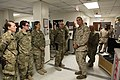 U.S. Marine Corps Sgt. Maj. Bryan B. Battaglia, right foreground, the senior enlisted adviser to the Chairman of the Joint Chiefs of Staff, speaks with hospital staff members at the Heathe N. Craig Joint Theater 130504-A-CL397-307.jpg