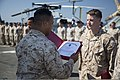 U.S. Marines and Sailors assigned to Alpha Company, Battalion Landing Team, 1st Battalion, 4th Marine Regiment, 13th Marine Expeditionary Unit conduct an awards ceremony aboard the amphibious transport dock USS 140309-M-KX613-031.jpg