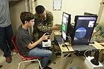 U.S. Marines and family members operate LAV simulator 151207-M-TJ275-381.jpg
