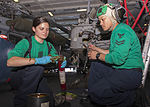 U.S. Navy Aviation Machinist's Mate 3rd Class Samantha Poile, left, and Aviation Machinist's Mate 2nd Class Roman Motos, both assigned to Helicopter Sea Combat Squadron (HSC) 7, conduct maintenance on 130724-N-CE241-009.jpg