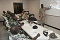 U.S. Navy Hospital Corpsman 3rd Class Paul McNair, right, discusses injury treatment with Kenyan sailors during a combat lifesaver course as part of Africa Partnership Station (APS) 2012 aboard high-speed vessel 120706-F-GA223-006.jpg