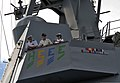 U.S. Navy officers on the starboard bridge wing of the guided missile destroyer USS Halsey (DDG 97) observe the ship as it arrives at Joint Base Pearl Harbor-Hickam, Hawaii 130214-N-WF272-067.jpg