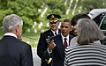 U.S. President Barack Obama gestures toward Secretary of Defense Chuck Hagel as he offers him a seat in his sedan as they move from the 145th annual Memorial Day observance to visit Section 60 at Arlington 130527-D-NI589-1008.jpg