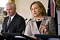 U.S. Secretary of State Hillary Rodham Clinton, right, responds to a question while U.S. Secretary of Defense Robert Gates looks on during a press conference with Australian Minister for Defense Stephen Smith 101108-D-JB366-012.jpg