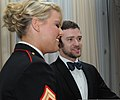 U. S. Marine Cpl. Kelsey De Santis, a Marine Corps Martial Arts Program instructor for the Martial Arts Center of Excellence, Instructor Battalion, and Justin Timberlake share a few moments in the V.I.P. room 111112-M-MS992-406.jpg