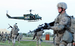37th Helicopter Squadron - A UH-1N belonging to the 37th Helicopter Squadron lands as 90th Security Forces Group move into place during an exercise that was part of the Nuclear Surety Inspection.