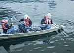 USS George Washington sailors collect debris 150119-N-DE001-017.jpg