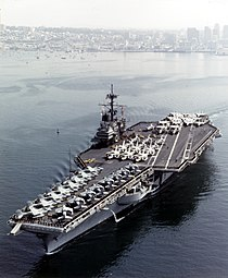 USS Ranger (CV-61) departing San Diego, in February 1987 (NH 97689-KN).jpg