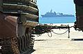 US Navy 040706-N-7586B-156 Armored Personnel Carriers APC frame the amphibious assault ship USS Belleau Wood LHA 3.jpg