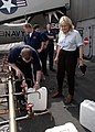 US Navy 050105-N-9293K-091 Journalist Diane Sawyer watches as Sailors aboard USS Abraham Lincoln (CVN 72) fill jugs with purified water from a Potable Water Manifold.jpg