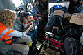 US Navy 050123-N-9885M-497 Melissa Higham, a relief worker from Sydney, Australia, shows footage from her video camera to Indonesian citizens as they are transported aboard MH-53E Sea Dragon helicopter.jpg
