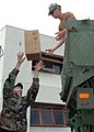US Navy 050831-N-7012S-002 U.S. Navy Seabees, assigned to Naval Mobile Construction Battalion Four Zero (NMCB-40), load-up boxes of Meals-Ready-to-Eat (MREs) in preparation for deploying to Gulfport, Miss.jpg