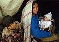 US Navy 051103-N-1261P-160 A Pakistani mother holds her month old infant at the Dewan Tent Village in Muzaffarabad, Pakistan.jpg