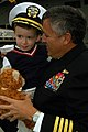 US Navy 051108-N-0050T-127 Commander, Destroyer Squadron Two Three, Capt. Mike Smith gives his son a teddy bear after departing the nuclear-powered aircraft carrier USS Nimitz (CVN 68) on board Naval Air Station North Island, C.jpg