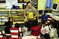US Navy 060302-N-1960H-093 USS Kitty Hawk (CV 63) Commanding Officer, Capt. Ed McNamee, reads a Dr. Seuss book to a 2nd grade class at Sullivans Elementary School.jpg