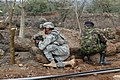 US Navy 060806-N-0411D-013 Guam Army National Guard Staff Sgt. Jay Antenocruz takes up a firing position with a Kenyan Army soldier at the perimeter of Natural Fire Headquarters as part of a mock attack drill.jpg