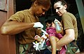 US Navy 070517-F-7806C-002 U.S. Navy Cmdr. Moultrie-Lizana from Detachment F Naval Hospital and Hospital Corpsman 2nd Class Ledbetter from Occupational Hospital Support Unit (OHSU) treats a Thai baby with a burn.jpg