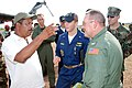 US Navy 070906-N-3666S-002 Capt. Daniel Fillion, executive officer aboard USS Wasp (LHD 1), meets with Puerto Cabezas Gov. Reynaldo Francis during an initial damage assessment of the area after the landfall of Hurricane Felix.jpg