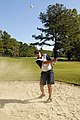 US Navy 070926-N-4515N-945 Information Systems Technician 1st Class Charles Lyon, a member of the U.S. Navy Golf Team, hits a bunker shot during the Armed Forces Golf Championship at Aeropines Golf Course on board Naval Air Sta.jpg