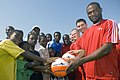 US Navy 071123-N-8483H-002 Sailors assigned to the amphibious dock landing ship USS Fort McHenry (LSD 43) present soccer balls to children in support of Africa Partnership Station (APS).jpg