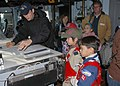US Navy 071209-N-4790M-080 On the bridge of command ship USS Blue Ridge (LCC 19) Engineman 3rd Class Christian V. Shields explains his job and responsibilities to members of Cub Scouts Pack 51.jpg