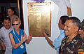 US Navy 080614-N-9689V-001 U.S. ambassador Kristie Kenney, left, and Calbayog City Mayor Mel Serimento unveil a completion plaque for the newly renovated Calbayog Health Clinic.jpg