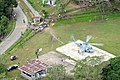 US Navy 080627-N-5961C-003 A helicopter assigned to Helicopter Anti-Submarine Squadron (HS) 4 delivers food and water to a small village in south Panay Island.jpg