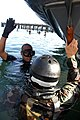 US Navy 080806-N-5366K-212 Chief Special Boat Operator Jeremy Gomez, left, a Basic Crewman Training (BCT) instructor, demonstrates a combat ascent to a student at Naval Amphibious Base Coronado.jpg