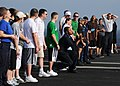 US Navy 080822-N-9898L-928 ailors aboard the aircraft carrier USS Abraham Lincoln (CVN 72) enjoy a water balloon toss game on the flight deck during a steel beach picnic.jpg