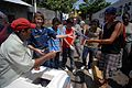 US Navy 090623-N-6259S-003 Lt. Cmdr. Teresa Whitson buys ice cream for Salvadoran children for their help picking up trash at Leon schoolhouse during a community service project.jpg