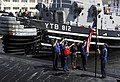 US Navy 090826-N-9928E-085 Sailors aboard the Los Angeles-class attack submarine USS Bremerton (SSN 698) raise the national ensign after pulling into port at Naval Base Kitsap, Wash., for a scheduled port visit.jpg