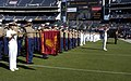 US Navy 091018-N-3581D-034 Navy ROTC San Diego members salute during the National Anthem at the San Diego State Aztecs vs. Brigham Young Cougars football pre-game ceremony in Qualcomm Stadium.jpg