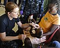 US Navy 100125-N-5345W-265 Lt. Adrienne Lawton xamines a Haitian infant at the Lifeline Christian Ministries Mission medical clinic in Grand Goave.jpg