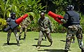 US Navy 100513-N-4971L-416 U.S. Marine Corps Sgt. Geormon Elder, from Atlanta, embarked aboard High Speed Vessel Swift (HSV 2), referees a sparring match between two members of the Jamaican Defence Force in Port Antonio, Jamaic.jpg