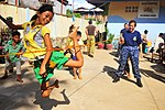 US Navy 100617-N-6597H-165 A Cambodian child plays jump rope with a Sailor from the Military Sealift Command hospital ship USNS Mercy (T-AH 19).jpg