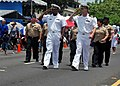 US Navy 100721-N-1722W-231 Sailors assigned to the submarine tender USS Frank Cable (AS 40) render honors to the commanders of Guam's military forces during Guam's 66th annual Liberation Day celebration parade.jpg