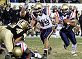 US Navy 101211-N-3066M-002 U.S. Naval Academy quarterback Ricky Dobbs (^4) runs the ball during the fourth quarter of the 111th annual Army-Navy fo.jpg