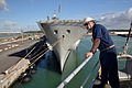 US Navy 110423-N-7293M-120 Chief Boatswain's Mate Robert Battles watches as USS Ponce (LPD 15) is pushed into its berth at Naval Base Rota, Spain.jpg
